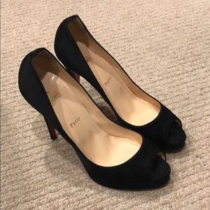 Black Satin Christian Louboutin peep toe pumps.